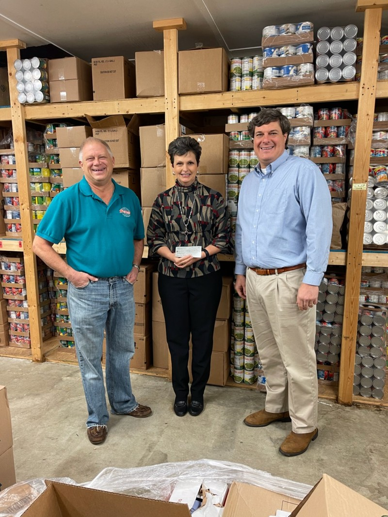 Walker Jordan, President and CEO of Bank of Monticello, presenting check to Kim McMichael, Jasper County Food Bank Board Member, and Ken Horton, Director, Jasper County Food Bank in Monticello, GA.